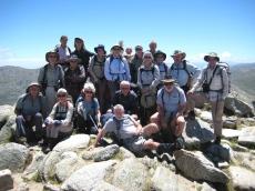 B walkers grouped around the Mt Kosciuszko cairn